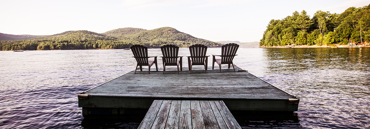 chairs on pier overlooking lake
