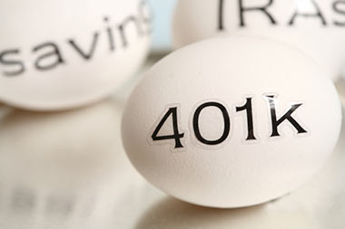 Three eggs with the words 401k, saving and IRAs written on them