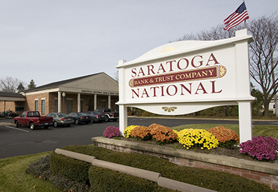 The Saratoga National Bank and Trust Company sign in front of one of the branches